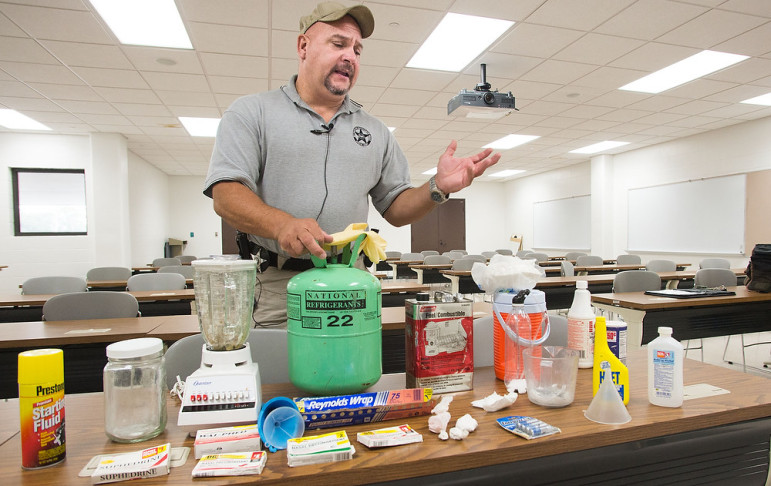 Illinois' Vermilion County Sheriff's deputy Patrick Alblinger talks about the area's meth problem and shows examples of lab components on Monday, Sept. 30, 2013.