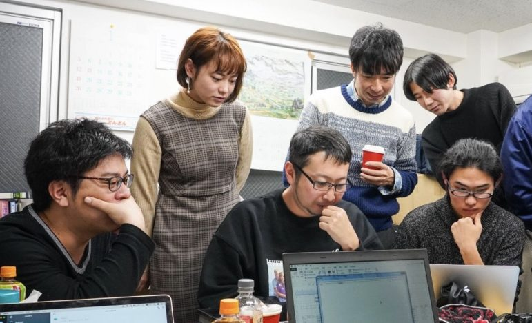 Makoto Watanabe (far left) and the Waseda Chronicle team at work. Image: Waseda Chronicle